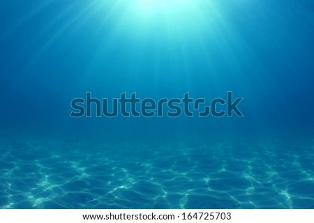 Underwater Background: Sunbeams in ocean - stock photo