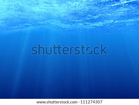 Underwater background with sunbeams in sea water - stock photo
