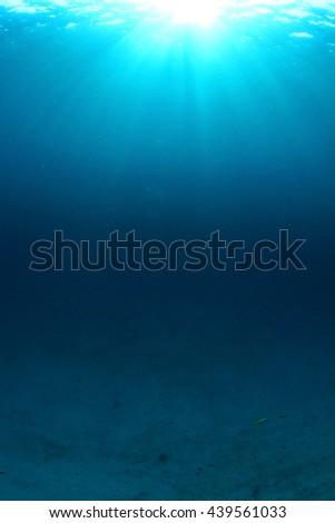 Underwater blue background in ocean - stock photo