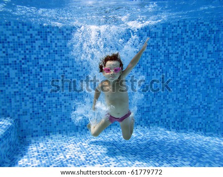 Underwater child, jump to the water in swimming pool - stock photo