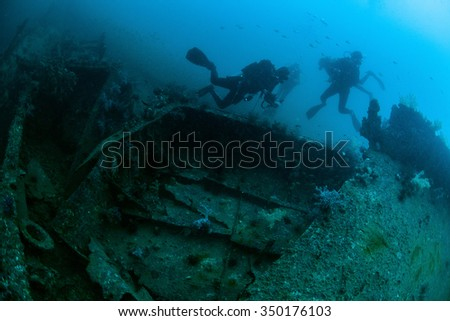 Underwater deep blue sea and scuba divers  - stock photo