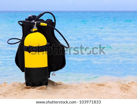 Underwater diving equipment on a tropical beach in Cuba - stock photo