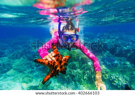 Underwater photo of girl with a starfish - stock photo