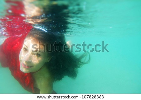underwater portrait of young beautiful woman - stock photo
