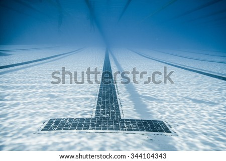 Underwater View of a Black Line Starts and Corridor of an Olympic 50m Pool - stock photo