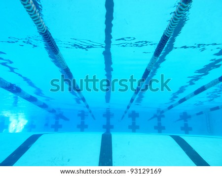 underwater view of lanes in pool - stock photo