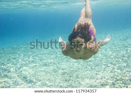 Underwater woman in the sea - stock photo