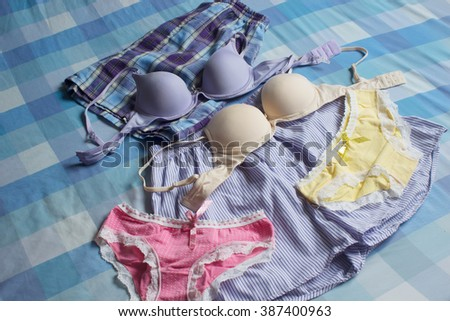 Underwear on the bed - stock photo
