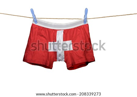 Underwear with the Swiss flag on a string against white background - stock photo