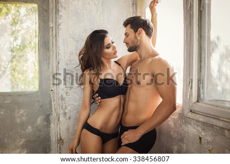 undress couple touching each other - stock photo