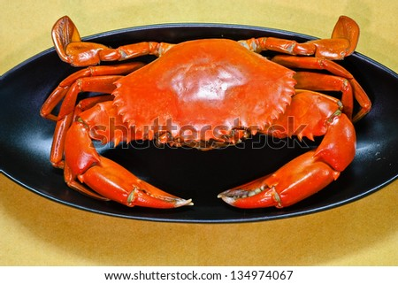 undressed roasted crabs prepared on plate. - stock photo
