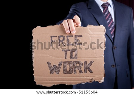 unemployed unrecognizable businessman showing a message in a cardboard that he needs a job - stock photo