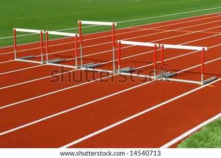 Uneven sized hurdles on race track - stock photo