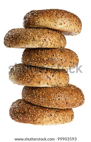 uneven stack of half dozen freshly baked everything bagels isolated on white background - stock photo