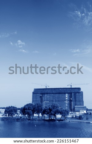 unfinished building on blue sky background, nearby the river, north china - stock photo