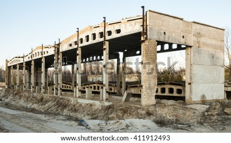 Unfinished construction of the industrial building. Concrete framework. - stock photo