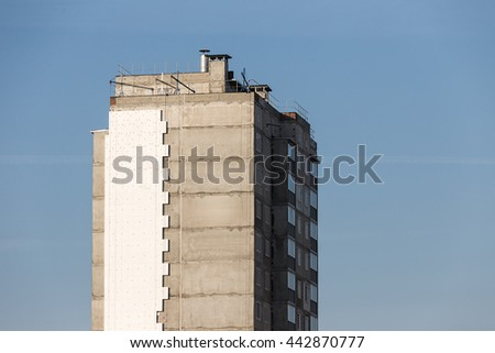 Unfinished high-rise building - stock photo