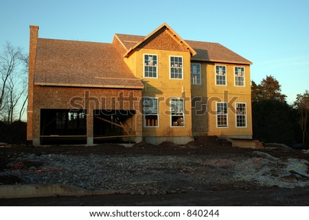 Unfinished home shot at sunset. - stock photo