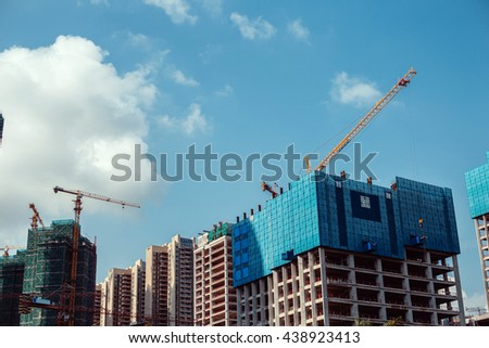 Unfinished houses on a background of clear sky. - stock photo