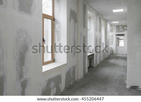 Unfinished interior of business center under construction  - stock photo
