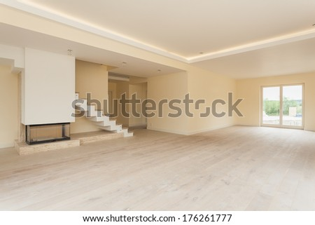 Unfinished interior of modern living room in new house - stock photo