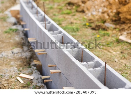 Unfinished outdoor wall being built at construction site. - stock photo