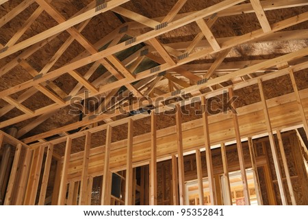 Unfinished Room showing 2x4 Studs and Roof Joyce - stock photo