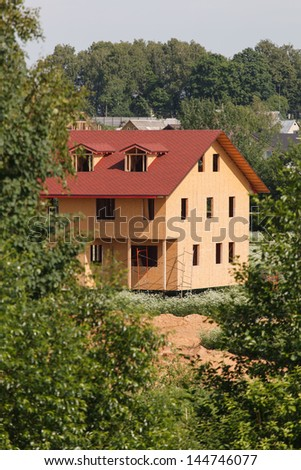 Unfinished wooden house - stock photo