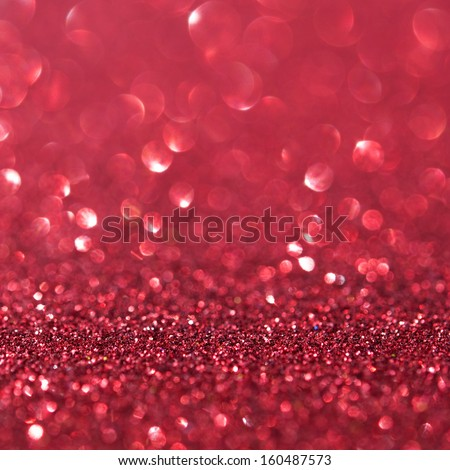 Unfocused abstract red glitter holiday background - stock photo