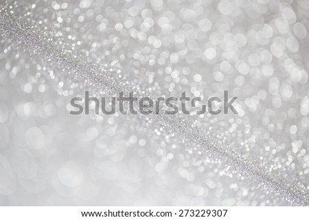 Unfocused abstract silver glitter holiday background - stock photo