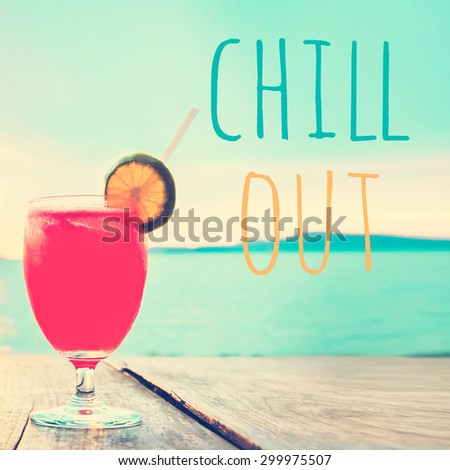 Unfocused cocktail drink on wood table in summer sea and sky background, vintage tone - chill out poster concept - stock photo