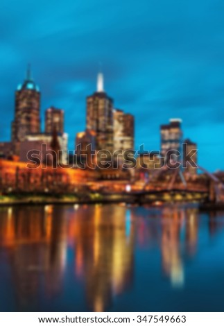 Unfocused Melbourne City background at night - stock photo