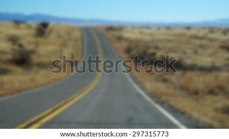 Unfocused scenic of Highway 163 through Monument Valley, Arizona - stock photo