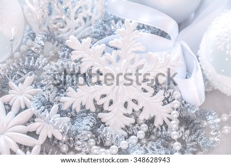 Unfocused Silver and white snowflake glitter bokeh holiday background. Winter xmas holidays card. Christmas.  - stock photo