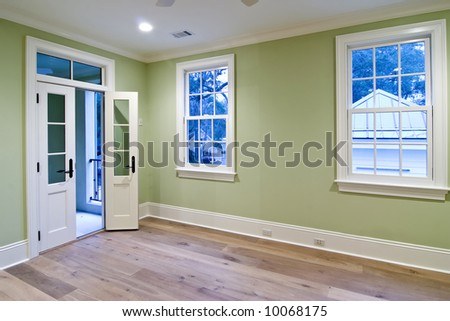 unfurnished bedroom with open door to porch - stock photo