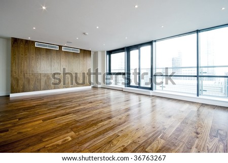 unfurnished penthouse living room with floor to ceiling windows - stock photo