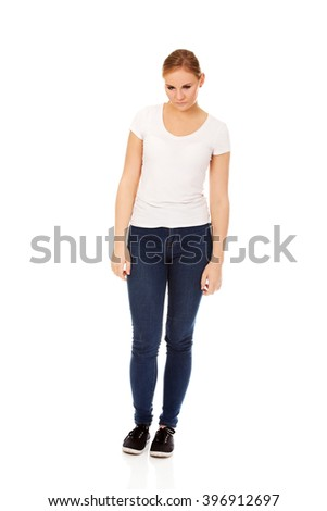 Unhappy and thoughtful young woman - stock photo