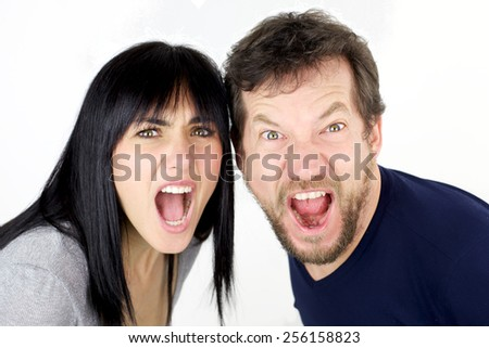 Unhappy angry couple screaming strong - stock photo