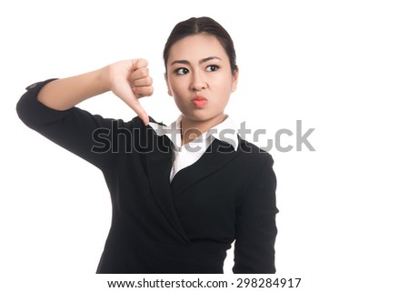Unhappy asian woman giving thumbs down gesture looking with negative expression and disapproval with blank copy space,isolated on white background - stock photo