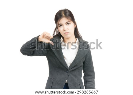 Unhappy asian woman giving thumbs down gesture looking with negative expression and disapproval with blank copy space,Thai girl,isolated on white background - stock photo