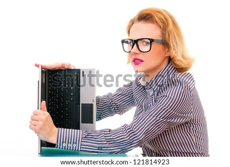 Unhappy business woman holding defective laptop, studio shot - stock photo