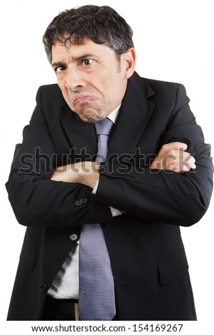 Unhappy businessman standing with his arms folded grimacing , isolated on white - stock photo