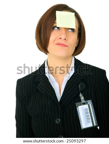 unhappy businesswoman has blank empty post it note on her forehead - stock photo