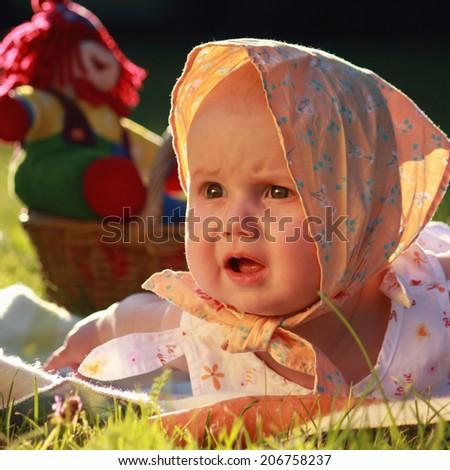unhappy child on black background - stock photo