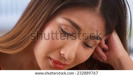 Unhappy Chinese businesswoman - stock photo