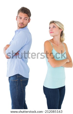 Unhappy couple not speaking to each other on white background - stock photo