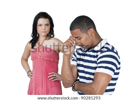 Unhappy couple with focus on man holding head - stock photo