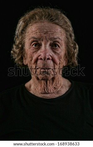 Unhappy Elderly Old Woman on Black Background - stock photo