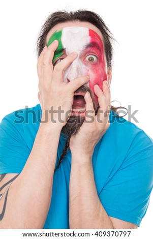 unhappy Fan from the national Team of Italy smearing the Flag above his face, isolated on white - stock photo