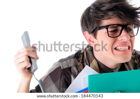 Unhappy geeky man being shouted at on the phone, isolated on white - stock photo